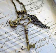 Flying dove key necklace