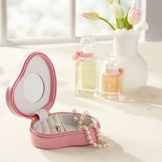 Le Coeur Leather Jewelry Box | Wrapped in leather, this heart-shaped jewelry box keeps treasured gems close at hand. Equipped with ring rolls and a compartment for necklaces and bracelets, it includes an interior mirror for last-minute touch ups.