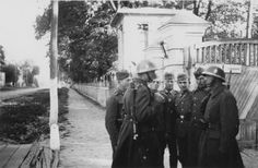 German and Slovak soldiers talk on the street of an unidentified Soviet city, Slovakia sent troops to fight alongside the Germans on the Eastern Front. Like the rest of Germany's allies against Russia, the Slovaks were decimated. by carol. Troops, Soldiers, Prisoners Of War, Soviet Union, World War Ii, Ww2, Germany, The Unit, History
