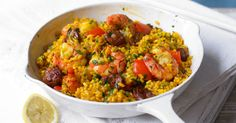 An easy mid-week favourite full of warmth and flavour, ready in just 30 minutes 30 minutes Serves 2 Easy onion 1, sliced red pepper 1, cut into chunks olive oil chorizo 100g, chopped into pieces paella rice 150g saffron a pinch chicken stock 400ml, hot cooked prawns 125g lemon 1, halved parsley a small bunch, …