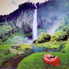 Curug Ngebul is located in Bunijaya Village Pagelaran District Cianjur Regency West Java. Ngebul waterfall is located at an altitude of 1000 meters above sea level (Mdpl). Panorama Curug Ngebul is still clean no garbage and original air of the mountains. The high cliffs loomed around him. Around the waterfall many other interesting places to visit such as Peteng Cave unique rocks such as Batu Kurung and Talaga Wastu. -  credit to #lavamilia