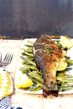 Grilled Branzino stuffed with lemon and herbs - SugarLoveSpices