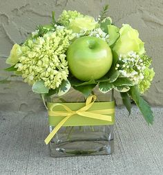 One of my all time favorite additions to floral arrangements...Granny Smith Apples. They are easy to add yourself with wooden floral picks (find at Michaels!)