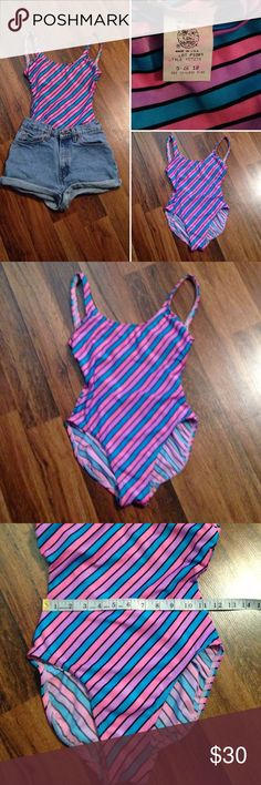 Vintage 70s Bathing Suit Refer to pictures for description and measurements. This was practically new. Worn once. However, when I washed it on gentle, the extremely thin layer of padding in chest lining washed away some. Doesn't alter the suit because it wasn't a thick padding. Otherwise it's awesome. Thank you! Tagged a vintage 12. Union Label. Vintage Swim One Pieces