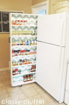 "DIY Canned Food Organizer Tutorial - for that odd 8-9"" space between the fridge & the wall - since we don't have too many canned goods, i'm thinking for spices, plastic wrap, etc..."