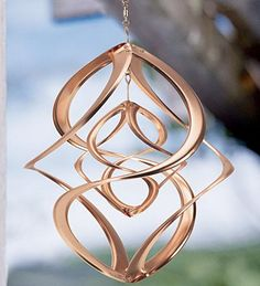 """Double Spin Wind Spiral. I have this copper spinner in my family room attached to a battery operated """"spinner"""" that keeps it revolving continuously. Because I keep it indoors the copper stays nice and shiny."""