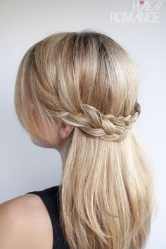 This sweet style from Hair Romance works beautifully for both straight and curly hair. Take substantial sections from both sides of the head, starting at the temples. Pull each braid across the back of the head to the opposite side, and pin into place. Tug at the braids to fluff them up. For added glamour, curl the rest of hair so it cascades down from the crown braid.