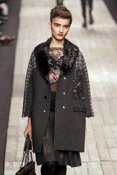 combining varied fabrics in knee-length coat by Antonio Marras at Milan Fall 2010