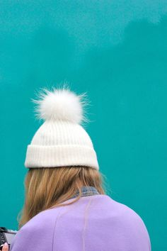 wgsn: Beautiful colour as a photographer checks her shots at Pom Pon, World Trends, Bobble Hats, Little Fashionista, Color Box, Fur Pom Pom, The Chic, Bag Accessories, Winter Fashion