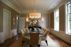 dining room with long table and chandelier