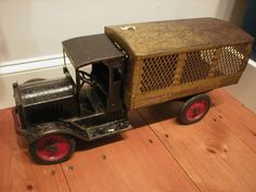 "From the Atwood House Archives: Toy mail truck, ""Keystone Packard Model"" Made in Boston . Painted rolled steel, Model 45. Cab is black, body green. Frame and wheels, red. Circa 1930. Belonged to Wayne and Ross Dimm who played with the toy when young. Donated by Wayne Dimm. #toy, #antique,#chatham, #capecod,#atwoodhouse,#chathamhistoricalsociety, #antique"