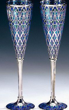 A PAIR OF PLIQUE À JOUR AND 18CT WHITE GOLD AND CHAMPAGNE FLUTES, MAKER'S MARK MM, LONDON. (Sotheby's)