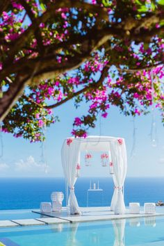 beach wedding ceremony idea; photo: Lightedpixels Photography via The Wedding Scoop