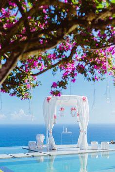 beach wedding ceremony idea; photo: Lightedpixels Photography via The Wedding Scoop