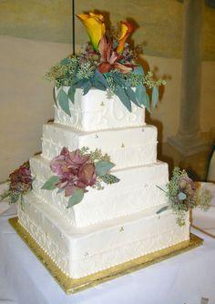 Buttercream iced wedding cake with fresh flowers