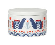 The Folklore short canister by Danica Studio is decorated with prettyScandinavian-inspired red and blue patterns.This ceramic container, which can be used in the kitchen, bathroom or on a dressing table, has a glossy finish.-5 x 3.25 (h) inches