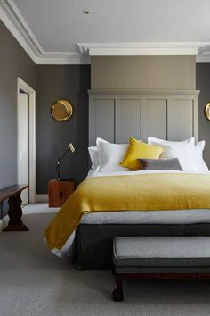 Discover bedroom ideas on HOUSE - design, food and travel by House & Garden. Discover bedroom ideas on HOUSE - design, food and travel by House & Garden. Mustard textiles complement grey walls in this London house. Mustard Bedroom, Bedroom Yellow, Mustard Walls, Yellow Walls, Yellow Sofa, Yellow Bedding, Yellow Throws, Grey Wall Bedroom, Gold Bedroom