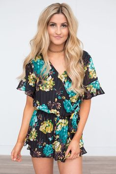 Shop our Tie Waist Floral Pleated Romper -in Black Multi. Featuring ruffle sleeves and a wrap front detail. Always free shipping on all US orders!