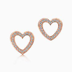 Heart earrings in 18k rose gold with diamonds.