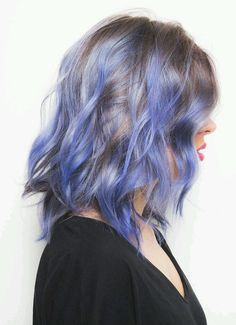Thinking about switching up your hair color? Try this purple hair color with blue highlights. The bright hair hue has an ombre effect that you can easily get on blonde hair.