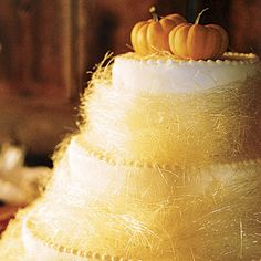 Sugar-Spun Straw Wedding Cake. A cake made of straw? Not quite, but this spun-sugar confection resembled the real thing, with mini pumpkins topping the three-tier spice cake.
