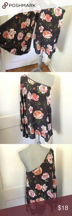 Asos one shoulder bell sleeve Floral Blouse Beautiful flowy asos Blouse in perfect condition. Bell sleeves are open on the bottom. Armpit to armpit is 21.5 length is 29 inches. ASOS Tops Blouses