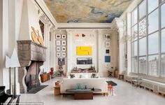 Height of taste: Floor-to-ceiling Corinthian columns give the feeling of being in a museum, castle, or giant public library and draw the eye upwards toward the magnificent mural in Venetian plaster