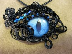 Wire Wrapped Dragon Eye pendant with by beadeddragondesigns, $60.00