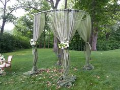 Earthy wedding canopy with diamond beading