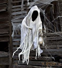 Life-Sized Halloween Ghost with Lantern is a spooky specter that will be the center of your Halloween festivities. Scary faceless design sends chills up our spines!