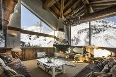 Sitting room with wooden beam ceiling, overlooking Val d'lsere Valley.