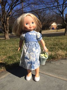 My Friend Mandy wearing purchased homemade dress and vintage shoes for Easter. Lots of eggs in her basket.