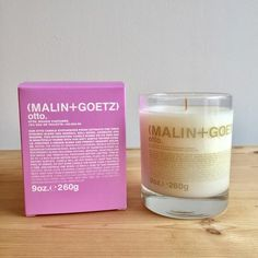 Malin + Goetz Otto Candle -  Latin for 'extract,' Otto is the synthesis of 20 garden extracts blended for personal interpretation. Be it floral, green, berry or earthy, Otto Candle is a dynamic collection of complementary notes combined to please the mind and enhance any environment. Top notes of grapefruit and cardamom; middle notes of geranium and rose; base notes of oakmoss and vetiver.