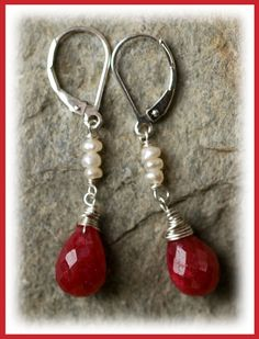 Romancing Rubies Earrings...  Sweet romantic Rubies wrapped in sterling silver...sway beneath a row of Freshwater Pearls. -Dangling from sterling leverback earwires.  Earrings measure......1.5 inches from top of earwire  Original Artisan Earrings Handcrafted by Cathy Dailey