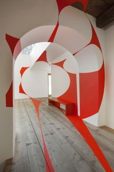 Abstract shapes appear to float in architectural space in a new installation by Swiss artist Felice Varini. His three-dimensional paintings are conceptual in nature but require the viewer to complete the form and become 'visible'. The works of Varini invite visitors to explore the gallery while becoming aware of their position amidst the geometrical arrays.