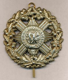 Victorian Scots Guards-note the VR (Victoria Regina) in the center of the pin.