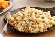 Roasted Cauliflower and Garbanzo Beans-This is an easy delicious italian-style side dish recipe. It's also  a low calorie, low fat, low carbohydrate, low cholesterol, low sodium, low sugar, (1 Carb Choice) Diabetic and a Weight Watchers (4) PointsPlus+ recipe. Makes 10 servings.