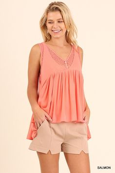 We love this High Lo sleeveless top with T back. Flirty and fun for a day out shopping or a trip to the winery!