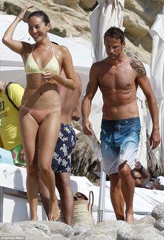 Jenson Button, British race car driver, and fiancee, Jessica Michibata, in Ibiza, Spain