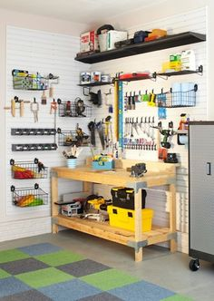 Martha Stewart - garages - green, gray, blue, carpet, tiles, wood, work station, black, plastic, tool, bins,  Work station in garage with carpet