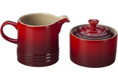 This pair of conveniently sized stoneware containers is the perfect compliment to coffee and tea, with a precision-pour spout for serving cream and a tight-fitting lid for storing sugar  - http://kitchen-dining.bestselleroutlet.net/product-review-for-le-creuset-stoneware-cream-and-sugar-set-cerise-cherry-red/