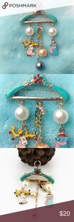 "Christmas Brooch Get ready for the holidays with this beautiful Christmas Brooch   3"" Long  Complete with a Reindeer, Pearls, Candy Cane and a Snowman all hanging from a beautiful blue hanger Accessories"