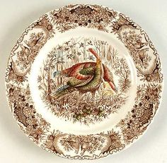 "Johnson Brothers has many turkey plate patterns to choose from. This one is called ""Woodland Wild Turkey."" Notice the detail around the rim."
