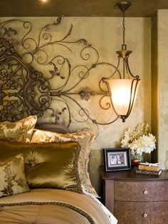 Decorating bedroom-- An ornate piece of iron work adds drama to this room. Finding that one special piece can change an entire room.