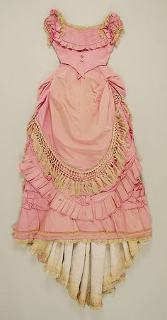 Pink silk dress with fringe trim (back, with evening bodice), French, 1871.
