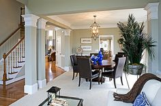 Gray and white columns define the dining room of the Providence plan built by Niblock Homes. New homes in the Kensington Forest community in Harrisburg, N.C.