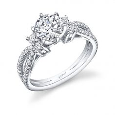 Engagement ring (#LC5280) This contemporary ring features an elegant marquise-shaped split shank encrusted with diamonds. Two diamonds on each side of the center stone add extra sparkle. #CoastDiamond