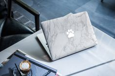 MacBook Skin Mock-Up by Temaphoto on Envato Elements