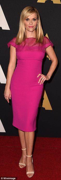 In the pink: Emily Blunt (L) and Reese Witherspoon were visions in shades of fuchsia at th...