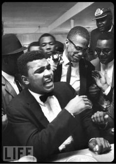 Boxer Muhammad Ali (L) having a laugh with activist Malcolm X (C, glasses) at the Hampton House shortly after gaining the heavyweight boxing championship. Heavyweight Boxing, World Heavyweight Championship, Sports Illustrated, Hip Hop Americano, Kentucky, Black Leaders, Float Like A Butterfly, By Any Means Necessary, Malcolm X